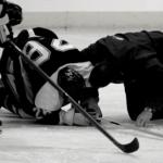 injured hockey play and coach