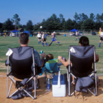 Parents watching youth sports game