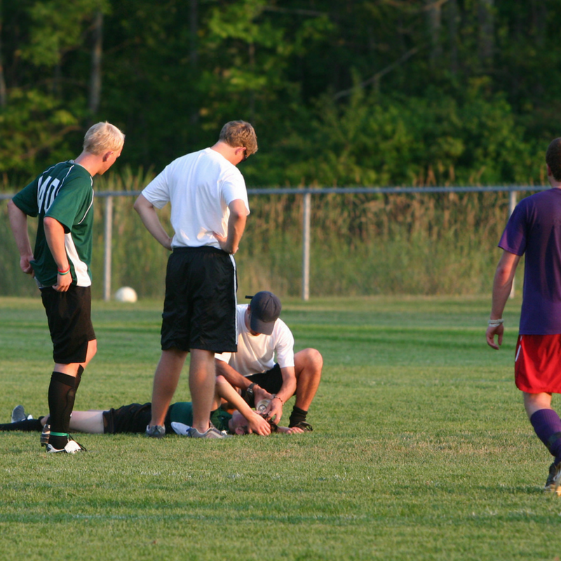 player on ground after sustaining head injury