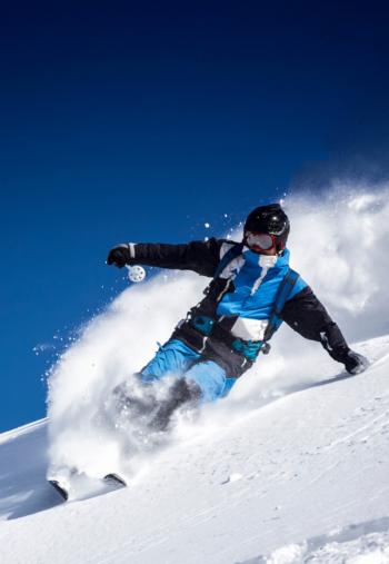 snowboarder shredding the slopes