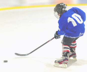 child playing ice hockey
