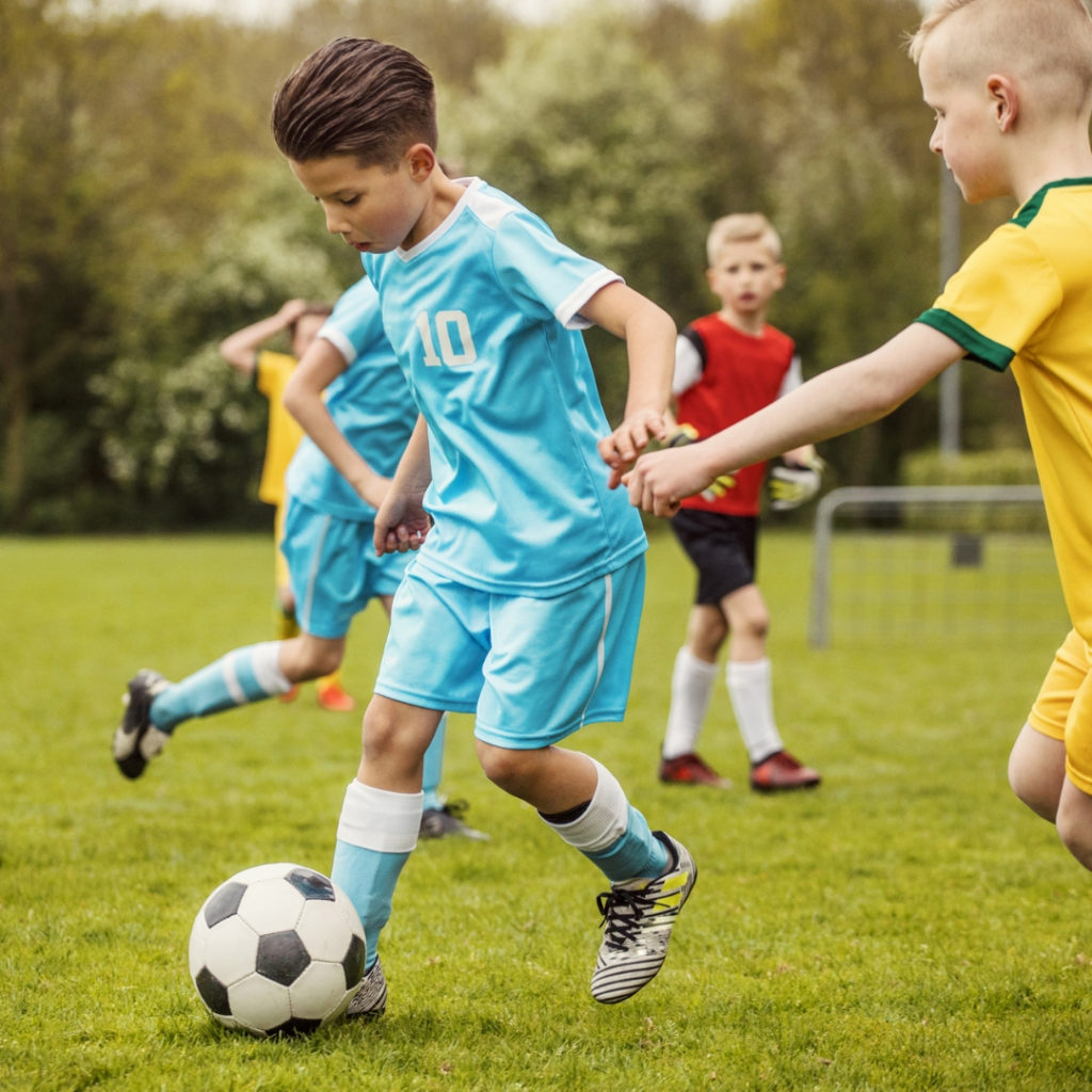 young soccer player dribbling