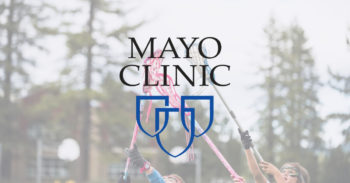 Mayo Clinic logo over lacrosse players